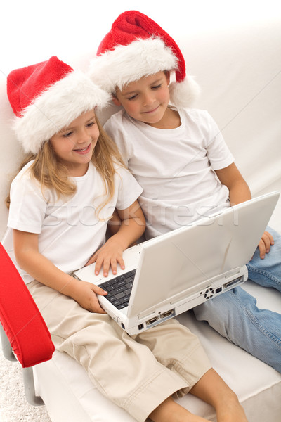 Kids searching for christmas presents online Stock photo © ilona75