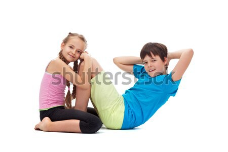 Kids doing gymnastic exercises together - helping each other Stock photo © ilona75