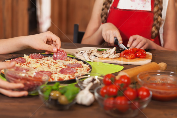 Kids making a pizza at home - closeup on hands Stock photo © ilona75