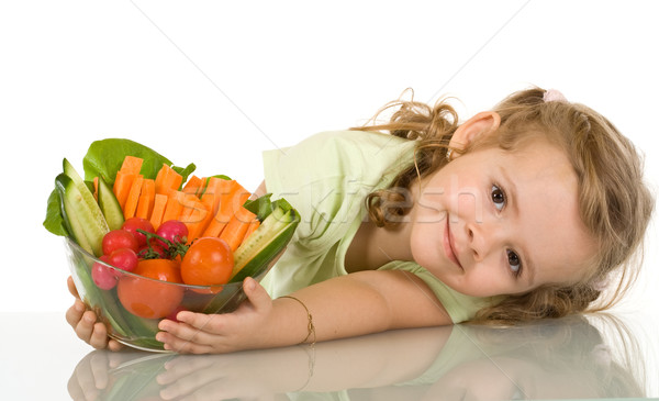 Little girl with a bowl of vegetables Stock photo © ilona75
