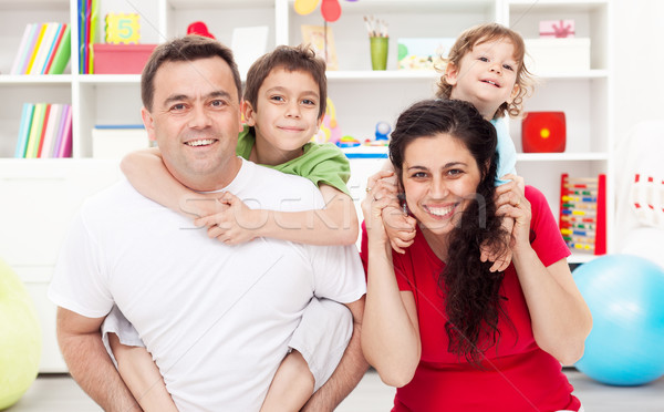 Happy family with two kids Stock photo © ilona75