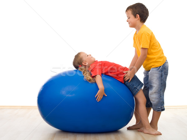 Trust my sister - kids playing with large rubber ball Stock photo © ilona75