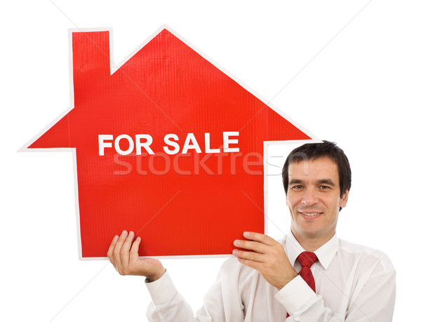 Salesman with house for sale sign Stock photo © ilona75