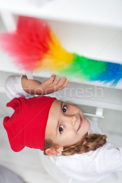 Stock photo: Little girl doing chores - dusting