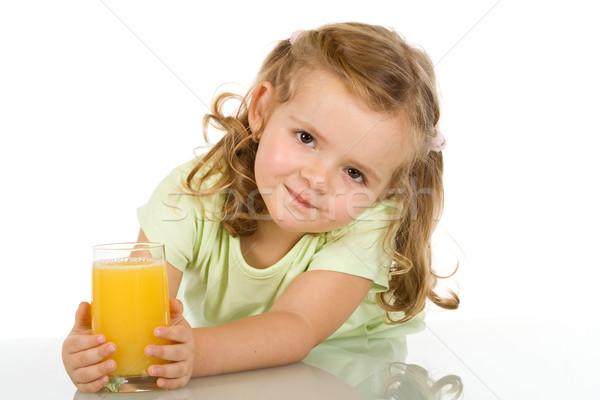 Little girl with fruit juice Stock photo © ilona75