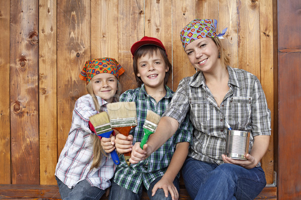 Woman with kids ready to paint the shed Stock photo © ilona75