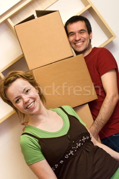 élvezi káosz mozog boldog pár karton Stock fotó © ilona75