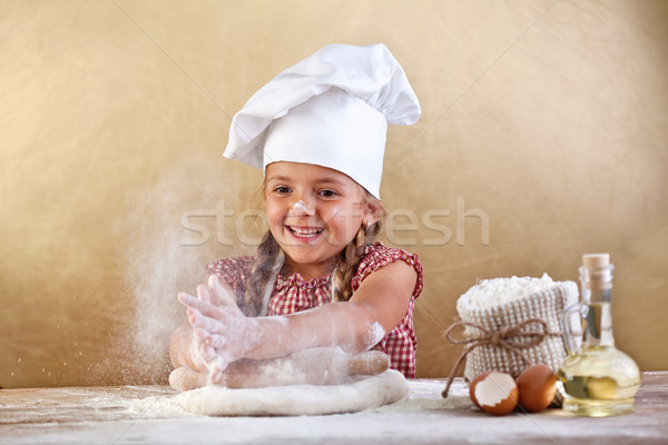 Making the dough for pizza is fun Stock photo © ilona75