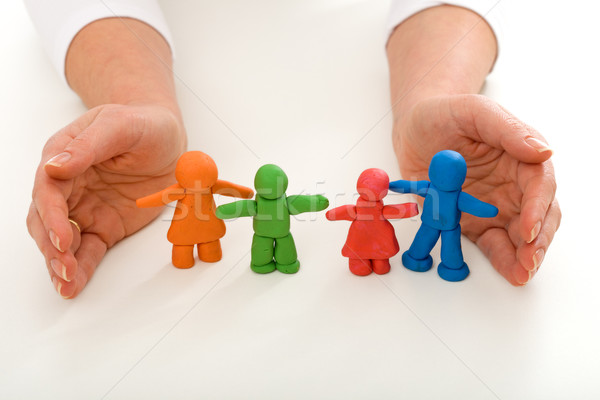 Woman hands protecting clay people family Stock photo © ilona75