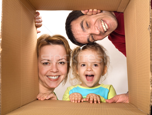 Family opening cardboard box - happy moving concept Stock photo © ilona75
