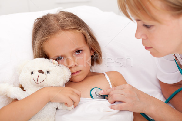 Health professional checking sick little girl Stock photo © ilona75