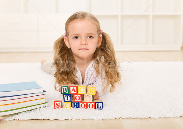 Little girl not too happy going back to school Stock photo © ilona75