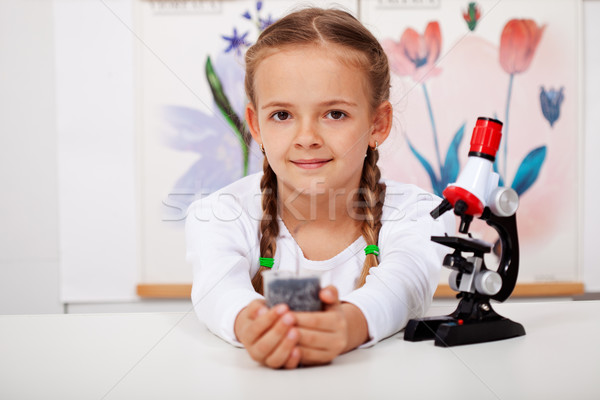 Young girl in biology class Stock photo © ilona75