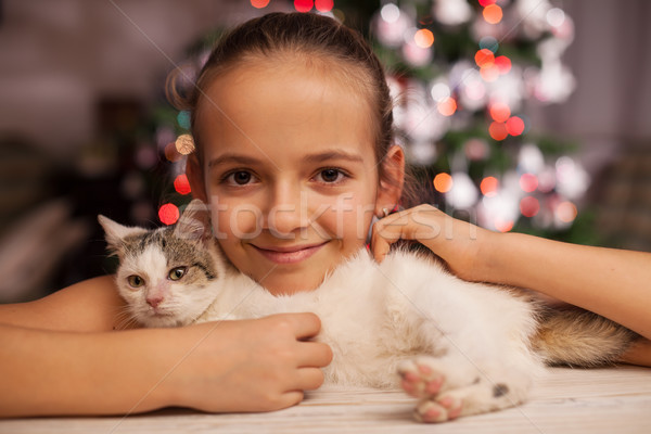 Young girl with the perfect christmas gift - a rescued kitten Stock photo © ilona75