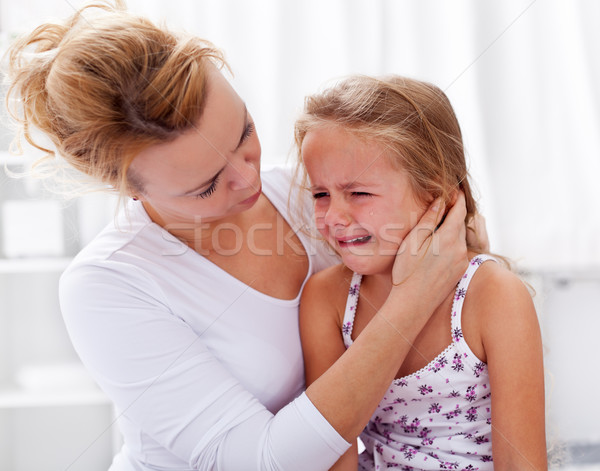 Stock photo: Mother comforting her crying little girl