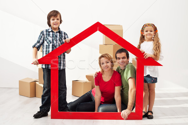 Happy family with kids moving into their new home Stock photo © ilona75