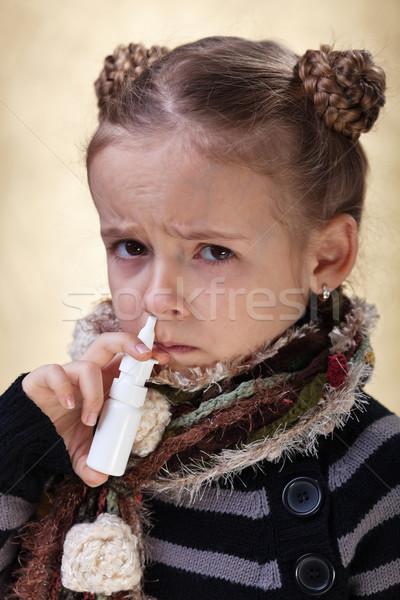 Little girl with the flu using nasal spray Stock photo © ilona75