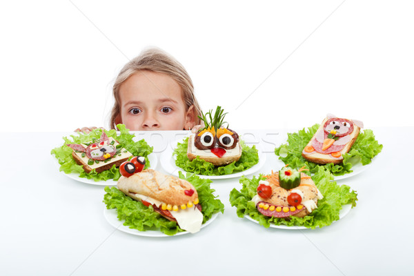 Little girl looking at creative food creatures Stock photo © ilona75