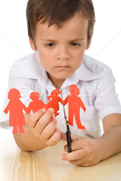 Stock photo: Sad boy cutting paper people family - divorce concept