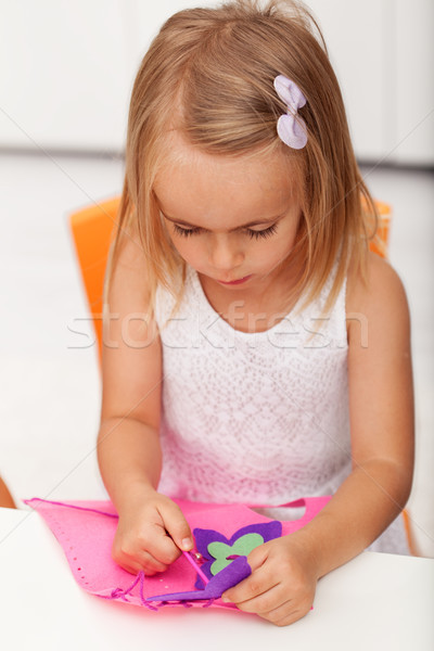 Little preschool girl doing some needlework on a crafting projec Stock photo © ilona75
