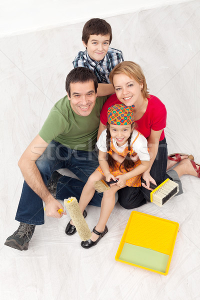 Family with paint preparing to redecorate their home Stock photo © ilona75