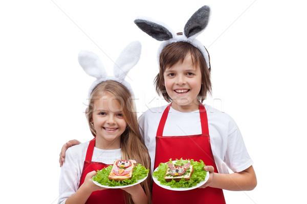 Happy chefs with bunny ears holding rabbit shaped sandwiches Stock photo © ilona75