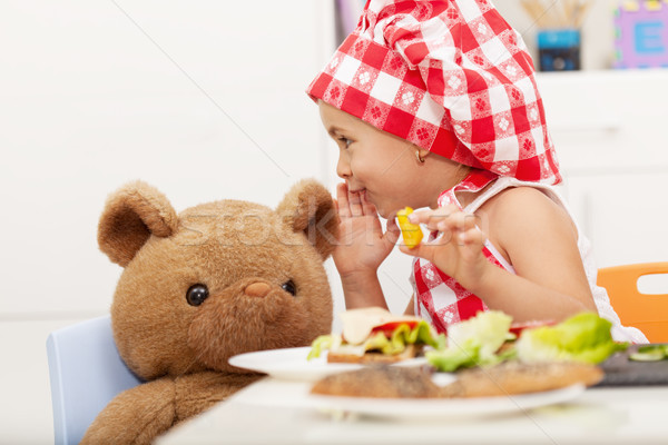 Little girl sharing secrets with her teddy bear Stock photo © ilona75