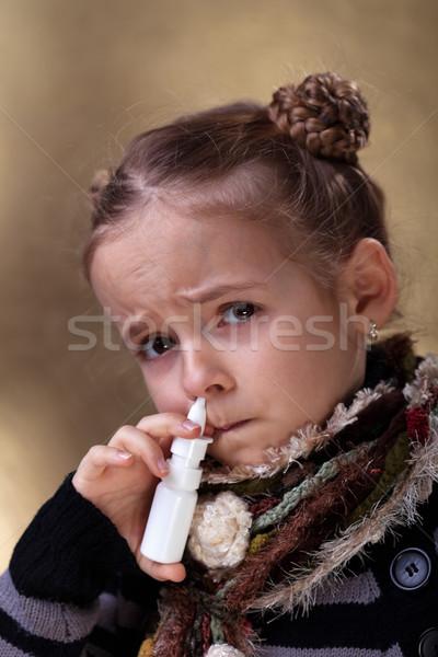 Young girl using nasal spray Stock photo © ilona75