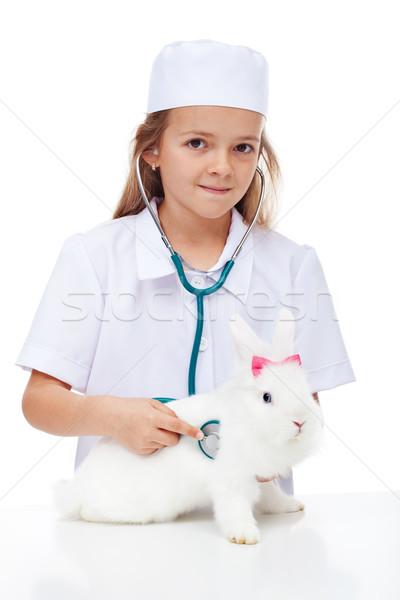 ストックフォト: 女の子 · 演奏 · 獣医 · ウサギ · ケア · ペット