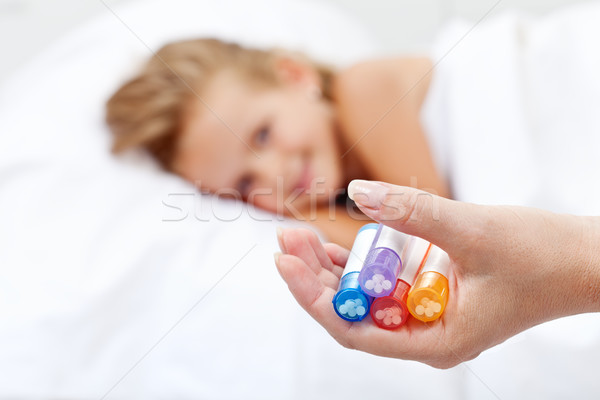 Little girl awaiting homeopathic medication Stock photo © ilona75