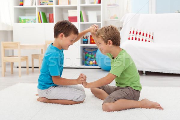 Kids wrestling on the floor Stock photo © ilona75