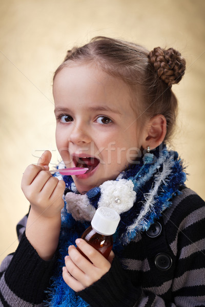 Little girl taking cough medicine syrup Stock photo © ilona75