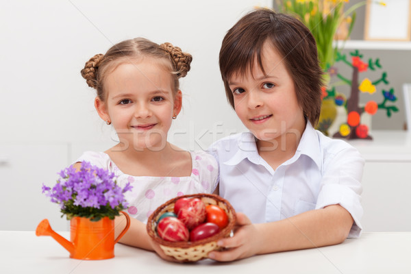 Kids dressed for celebration holding dyed easter eggs Stock photo © ilona75