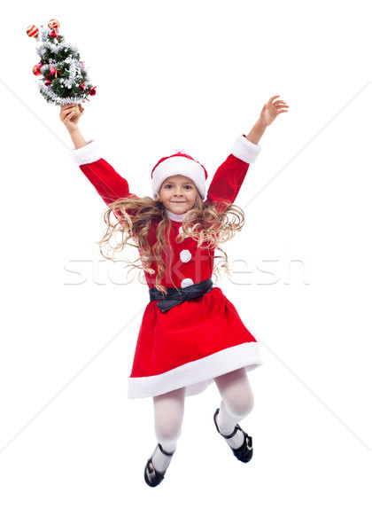 Little santa helper girl jumping - isolated Stock photo © ilona75
