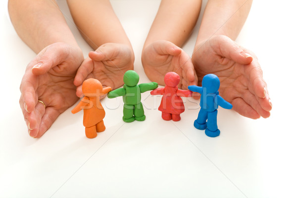 Woman and child hands protecting modelling clay people  Stock photo © ilona75