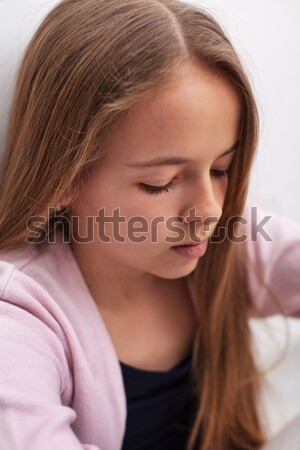 Sad teenager girl with downcast eyes - closeup portrait Stock photo © ilona75