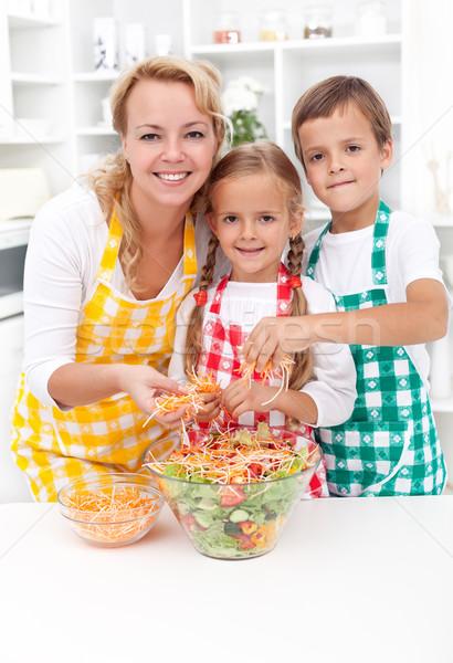 Happy family preparing fresh salad Stock photo © ilona75