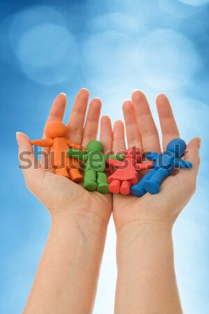 Woman hands holding colorful clay people family Stock photo © ilona75