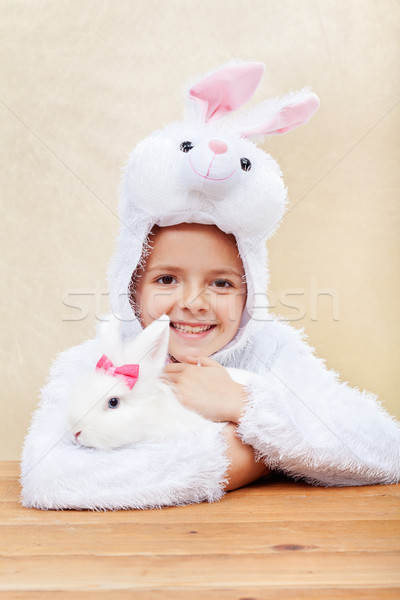 Cute little girl in bunny costume with white rabbit Stock photo © ilona75