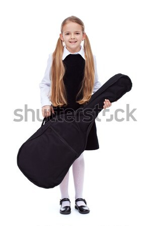 Learning to play a musical instrument - little girl with guitar Stock photo © ilona75