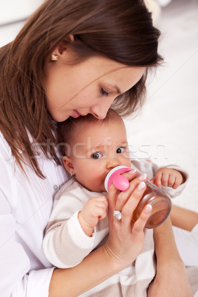 Baby girl drinking from bottle Stock photo © ilona75
