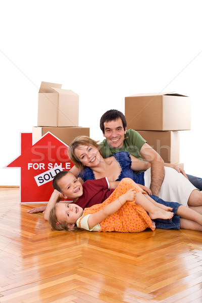 Happy family laying on the floor of their new home Stock photo © ilona75