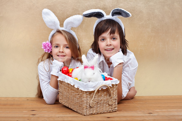 Kids with bunny ears and easter basket Stock photo © ilona75