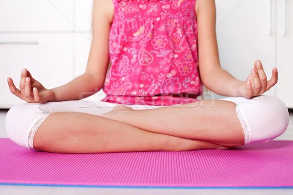 Fiatal lány lótusz pozició meditál otthon közelkép Stock fotó © ilona75