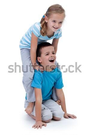 Gelukkig kinderen spelen worstelen samen familie glimlach Stockfoto © ilona75