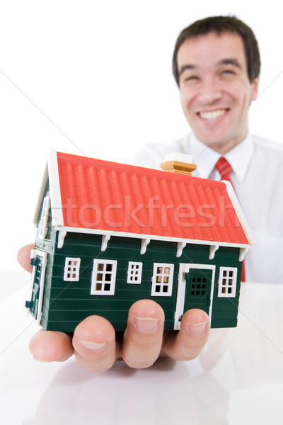 Ecstatic businessman with a miniature house Stock photo © ilona75