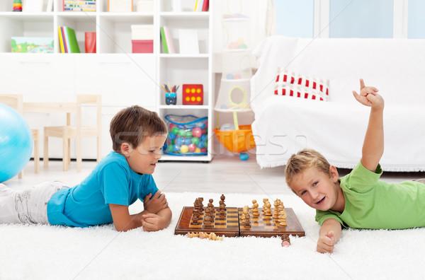 Garçon échecs jeu ami enfants Photo stock © ilona75