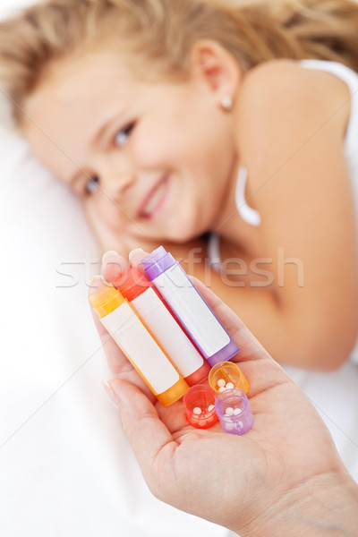 Stock photo: Little girl awaiting homeopathic medication