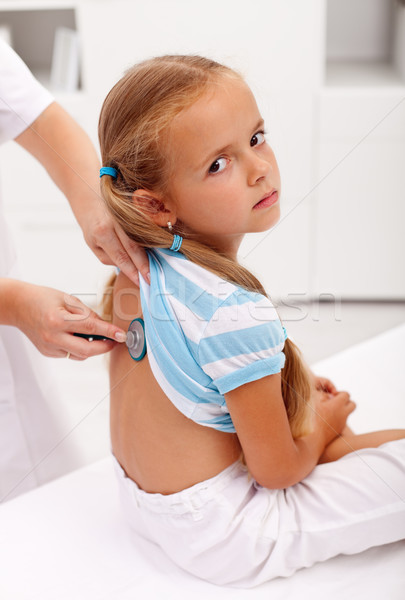 Little girl at the doctor for an examination Stock photo © ilona75