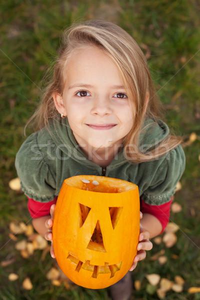 Autumn portrait with a Halloween pumpkin jack-o-lantern Stock photo © ilona75